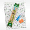 Paper scatter tooth design pictured with toothbrush